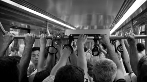 crowded-subway-car-hands-flickr